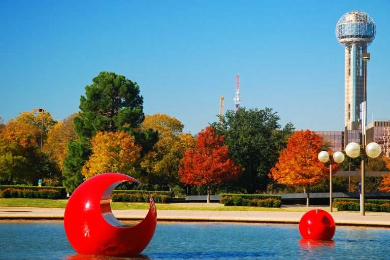 Red moon looking sculpture in a Dallas park
